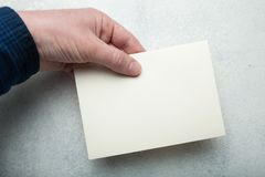 Beige pastel envelope for mail on a background of a light vintage table in hand. Template, mock-up royalty free stock photos