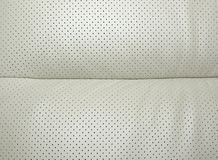 Beige perforated leather stock images
