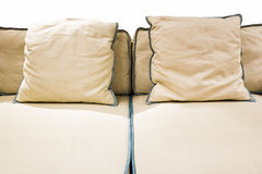 Beige pillows on a bed Stock Photography