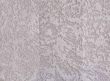 Beige plaster textured background. Abstact beige stucco. Texture of plaster on the wall. Close-up, macro. Some copy space for your text. Abstract textured royalty free stock image