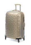 Beige plastic suitcase on wheels for travel. Stock Photography