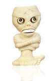 Beige plastic toy as a mummy Royalty Free Stock Images
