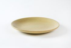 Beige plate Royalty Free Stock Images