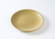 Beige plate Royalty Free Stock Photos