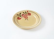 Beige plate with floral pattern Stock Image