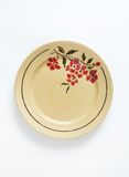 Beige plate with floral pattern Royalty Free Stock Photography