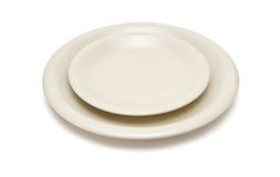 Beige plate and saucer isolated Stock Photos