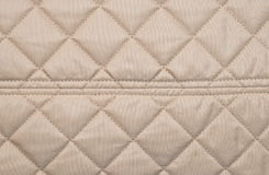 Beige quilted background Stock Photos