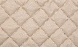 Beige quilted background Royalty Free Stock Photos
