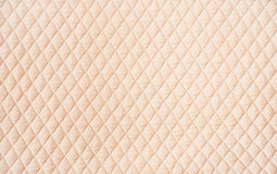 Beige quilted pattern background Stock Image