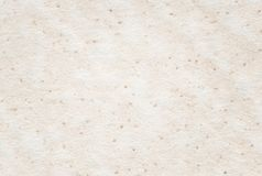 Beige recycled spotted horizontal note paper texture, light background. stock photography