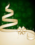 Beige ribbon on green background Royalty Free Stock Images
