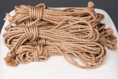 Beige ropes for bondage. Beige ropes of jute for bondage or shibari stock photo