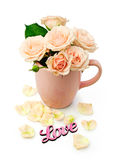 Beige roses in a cup Royalty Free Stock Images