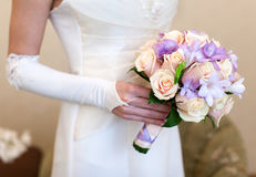 Beige roses and lilac irises bouquet Stock Images