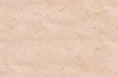 Beige rough paper seamless background. Macro photo with beige rough paper background Royalty Free Stock Photo