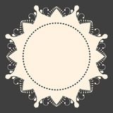 Beige round ornament copyspace frame. On dark grey background Royalty Free Stock Photography