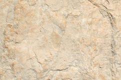 Beige rustikale Steinwand Lizenzfreies Stockbild