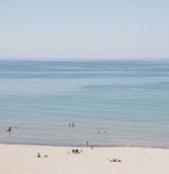 Beige Sand in Front of Seashore during Daytime Royalty Free Stock Photo