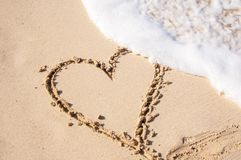 Beige Sand With Hear Engrave royalty free stock photo