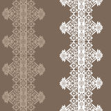 Beige seamless lace pattern on brown Stock Image