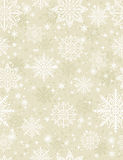 Beige seamless pattern background with snowflakes and stars royalty free stock image