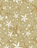 Beige seamless pattern background with snowflakes and stars stock photography