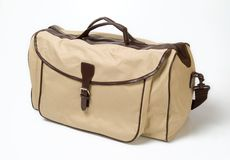 Beige shoulderbag. Beige and brown textile sport-style travel shoulderbag Royalty Free Stock Photography