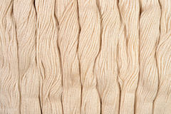 Beige skeins of floss as background texture Royalty Free Stock Photo