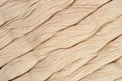 Beige skeins of floss as background texture Stock Photo