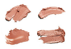 Beige smear paint of cosmetic products Stock Photos