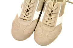 Beige sneakers Royalty Free Stock Image