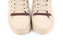 Beige sneakers. Royalty Free Stock Photos