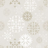 Beige Snow Background. Elegant beige and white background depicting various abstract snowflakes. Seamlessly repeatable Stock Images