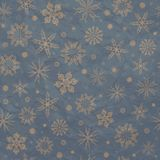 Beige snowflakes on a blue background. Royalty Free Stock Image