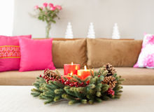Beige sofa with advent flower arangement Royalty Free Stock Images