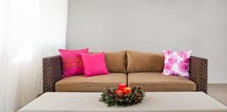 Beige sofa with advent flower arangement Royalty Free Stock Photo