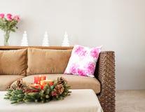 Beige sofa with advent flower arangement Stock Photos