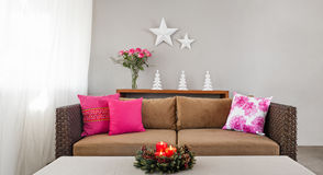 Beige sofa with advent flower arangement Royalty Free Stock Image