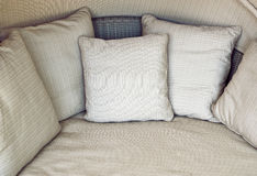 Beige sofa with cushions Stock Image