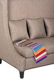 Beige sofa from impressive fabric. Stylish couch and cushions in beige basket weave cloth, and cloth colour samples, for home and office interior royalty free stock photo