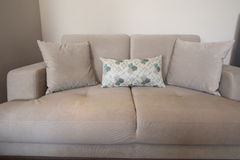 Beige sofa in living room Stock Photo