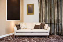 Beige sofa in luxurious living room Royalty Free Stock Photos