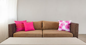 Beige sofa with pillows Stock Photo