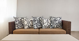 Beige sofa with pillows Stock Images