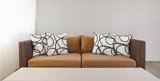 Beige sofa with pillows Stock Photos