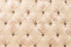 Free Beige Soft Tapestry Pattern Background With Symmetrical Buttons On The Corners Of Diamonds. Soft And Expensive Furniture Stock Photos - 123987823