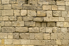 Beige stone brick wall Stock Images