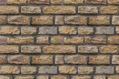 Beige stone chipped uneven weathered hard background base of many rectangular blocks stock photos