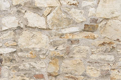 Beige stone mosaic wall background texture Stock Photography